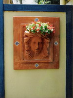Roman woman Imogen wall plaque and planter with hand painted tiles, aged terracotta semi formal finish.