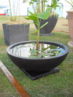 large garden water bowl on base, black volcanic scoria finish